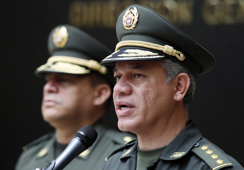 Colombia National Police Chief Gen. Jose Roberto Leon, right, talks during a press conference about the capture of a top fugitive Italian cocaine boss, at police headquarters in Bogota, Colombia, Saturday, July 6, 2013. Roberto Pannunzi, believed to be one of the world's most powerful drug brokers and who prosecutors allege arranged monthly shipments of tons of South American cocaine to Europe, has been captured in Bogota in a shopping mall, Gen. Leon said. (AP Photo/Fernando Vergara)