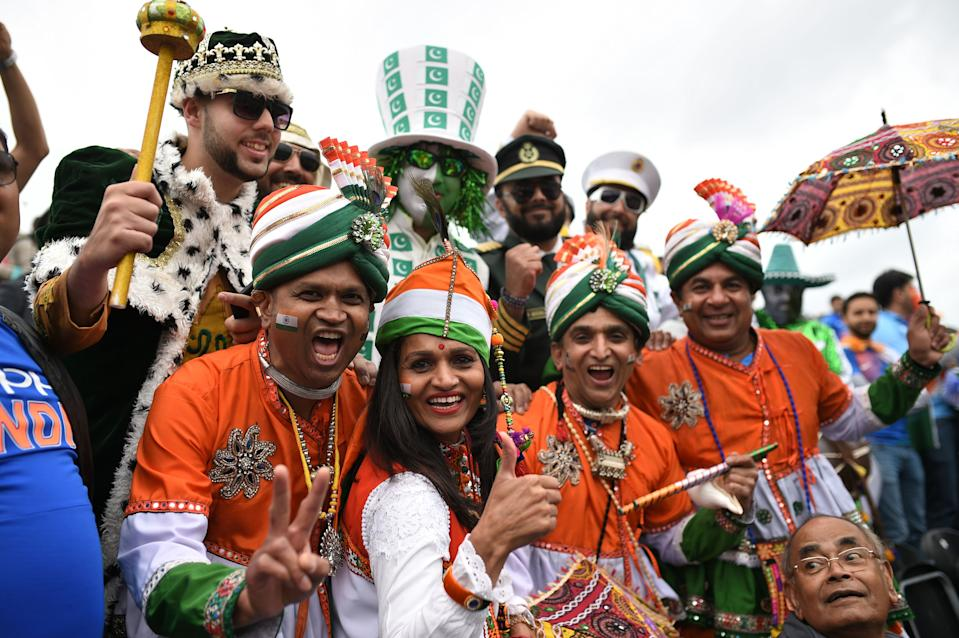 Pakistan and India supporters enjoy the build-up in the crowd (Photo by OLI SCARFF/AFP/Getty Images)