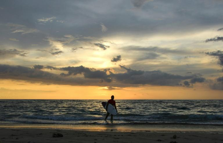 Indonesian Dery Setyawan, a survivor of the December 26, 2004 tsunami, believes surfing helps him cope with the trauma (AFP Photo/Chaideer MAHYUDDIN)