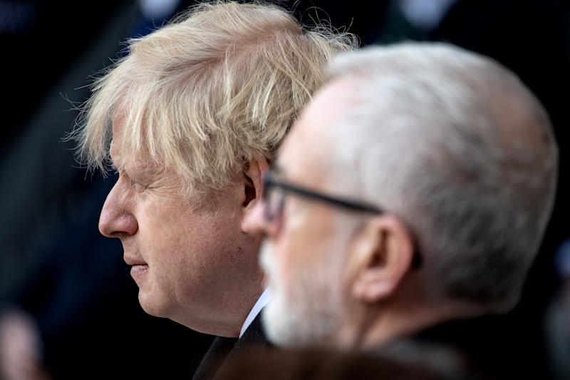 LONDON, ENGLAND - DECEMBER 02: (L-R) Prime Minister, Boris Johnson and Labour Leader, Jeremy Corbyn attend a vigil for victims Jack Merritt, 25, and Saskia Jones, 23 of the London Bridge attack and to honour the public and emergency services who responded to the incident at the Guildhall Yard on December 2, 2019 in London England. Usman Khan, a 28 year old former prisoner convicted of terrorism offences, killed two people in Fishmongers' Hall at the North end of London Bridge on Friday, November 29, before continuing his attack on the bridge. Mr Khan was restrained and disarmed by members of the public before being shot by armed police. (Photo by Leon Neal/Getty Images)