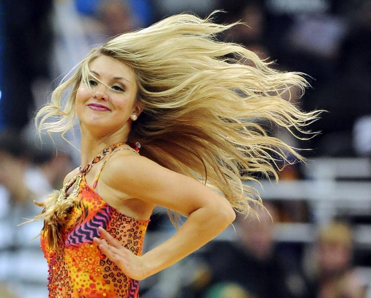 A member of the Utah Jazz Dance Team performs in the second half of an NBA basketball game against the Charlotte Bobcats, Monday, Dec. 30, 2013, in Salt Lake City. Jazz won 83-80. (AP Photo/Gene Sweeney Jr.)