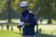 Xander Schauffele, of the United States, reacts on the second green during the third round of the US Open Golf Championship, Saturday, Sept. 19, 2020, in Mamaroneck, N.Y. (AP Photo/John Minchillo)