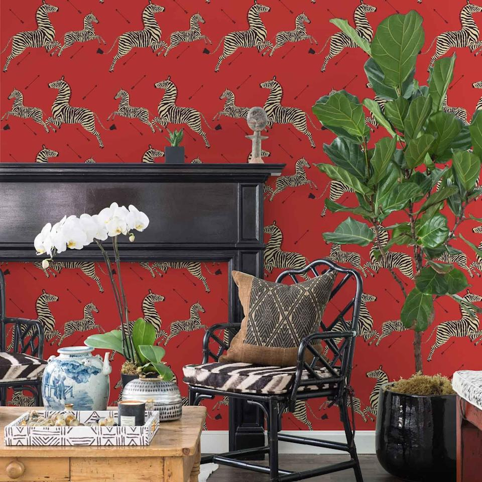 """<p>Calling all design lovers who live in rentals—or have trouble sticking to just one pattern: If you're a lover of iconic prints who needs temporary wallpaper, you're going to be thrilled about NuWallpaper's newest collection. Today, the peel-and-stick wallpaper company unveiled its latest line with Scalamandré, the design house between such recognizable prints as the famous leaping zebras, coquina shells, and more. While the iconic red zebra pattern was made available as part of <a href=""""https://www.housebeautiful.com/shopping/a26328114/the-inside-scalamandre-announcement/"""" rel=""""nofollow noopener"""" target=""""_blank"""" data-ylk=""""slk:a collab with The Inside"""" class=""""link rapid-noclick-resp"""">a collab with The Inside </a>last year, the NuWallpaper collection comprises four different patterns, all in a slew of colors, to make for an impressive range of high design patterns–all for just $79–$99 per roll. Thanks to high-quality printing and bold colors, the temporary versions are nearly indistinguishable from their more traditional cousins. Don't have a free wall? Trust us, there's plenty more you can do with peel and stick—say, lining the insides of doors, creating mock chinoiserie panels, or jazzing up a backsplash—<a href=""""https://www.housebeautiful.com/shopping/home-accessories/g1324/peel-and-stick-removable-wallpaper-1212/"""" rel=""""nofollow noopener"""" target=""""_blank"""" data-ylk=""""slk:find some other ideas here."""" class=""""link rapid-noclick-resp"""">find some other ideas here. </a> Shop some of our favorites below and see the <a href=""""https://www.wallpops.com/scalamandre-signature-self-adhesive-wallpaper"""" rel=""""nofollow noopener"""" target=""""_blank"""" data-ylk=""""slk:entire collection here."""" class=""""link rapid-noclick-resp"""">entire collection here. </a></p>"""
