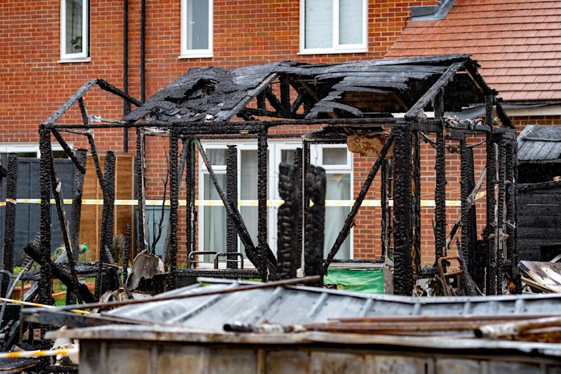 A freak fire left three families homeless after a shard of glass reflected onto a wooden fence (SWNS)