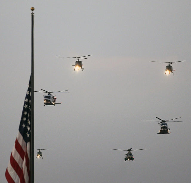 Helicopters fly over Dodger Stadium in memoryof the 2001 terrorist attacks before a baseball game between the Los Angeles Dodgers and the Arizona Diamondbacks, Wednesday, Sept. 11, 2013, in Los Angeles. (AP Photo/Jae C. Hong)