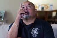 Will Jimeno, the former Port Authority police officer who was rescued from the rubble of the Sept. 11, 2001 attacks at World Trade Center, describes the experience during an interview in his home in Chester, N.J., Monday, Aug. 2, 2021. Buried in darkness and 20 feet (6 meters) or more of rubble from both towers, Jimeno was ready to die. (AP Photo/Richard Drew)
