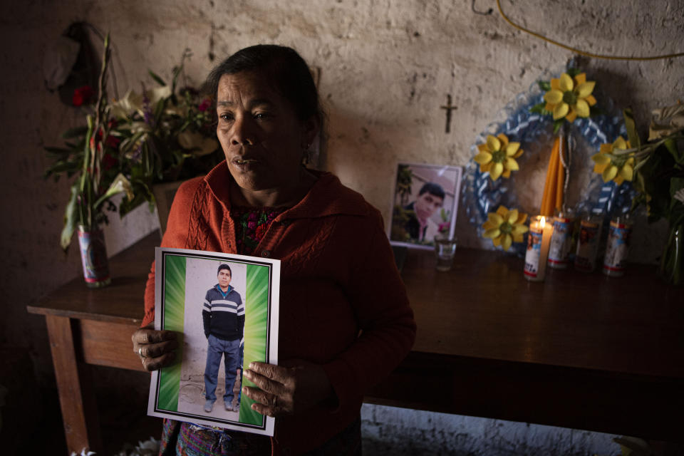 Elena Marroquin poses for a portrait holding a photo of her grandson Rivaldo Danilo Jimenez, in her home in Comitancillo, Guatemala, Wednesday, Jan. 27, 2021. She believes that her grandson was one of 19 bodies, shot and burned, found in late January, inside a pickup truck near the Mexico-Texas border. (AP Photo/Oliver de Ros)