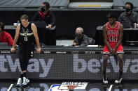 Milwaukee Bucks guard Sam Merrill, left, and Chicago Bulls forward Patrick Williams watch teammates during the first half of an NBA basketball game in Chicago, Sunday, May 16, 2021. (AP Photo/Nam Y. Huh)