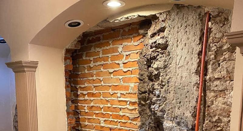 A brick wall found behind a hidden door in a Mexican house.