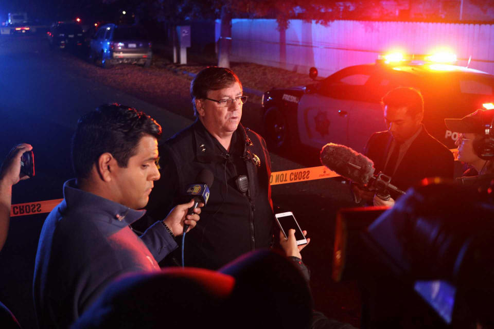 Fresno Police Lt. Bill Dooley speaks to reporters at the scene of a shooting at a backyard party Sunday, Nov. 17, 2019, in southeast Fresno, Calif. (Photo: Larry Valenzuela/The Fresno Bee via AP)