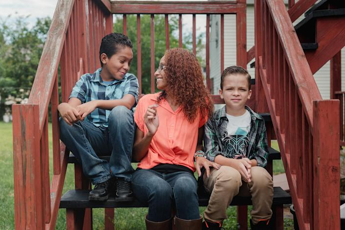 Shy Rodriguez with her sons, Shawn Pagan, 11, left, and Jaiden Pagan, 8, at their home in Wilkes-Barre, Pa., on July 31, 2020. (Hannah Yoon/The New York Times)