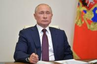 Russian President Vladimir Putin takes part in a a video conference call outside Moscow