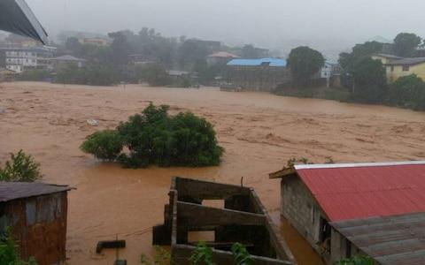 <span>Houses were left submerged in mud after a night of heavy rain that saw a hillside in the Regent area collapse</span> <span>Credit: Society for Climate Change Communication Sierra Leone </span>