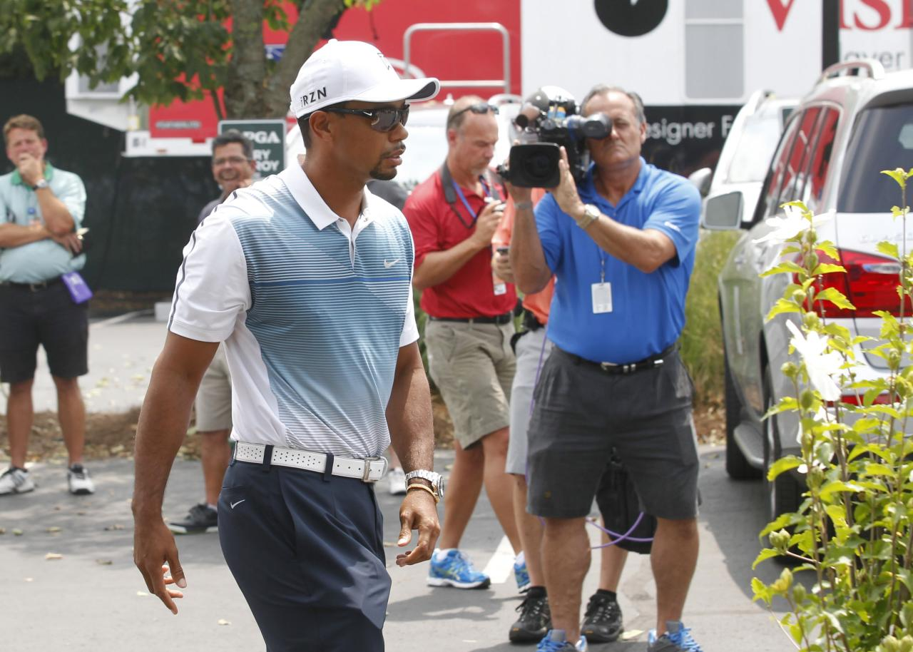 Tiger Woods of the U.S. arrives at Valhalla Golf Club for the third day of practice for the 96th PGA Championship at Valhalla Golf Club in Louisville, Kentucky, August 6, 2014. REUTERS/ John Sommers II (UNITED STATES - Tags: SPORT GOLF)