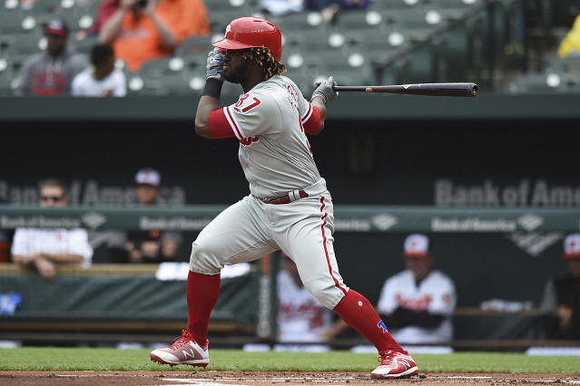 Philadelphia Phllies' Odubel Herrera follows through on a single against the Baltimore Orioles in the first inning of baseball game, Wednesday, May 16, 2018, in Baltimore. (AP Photo/Gail Burton)