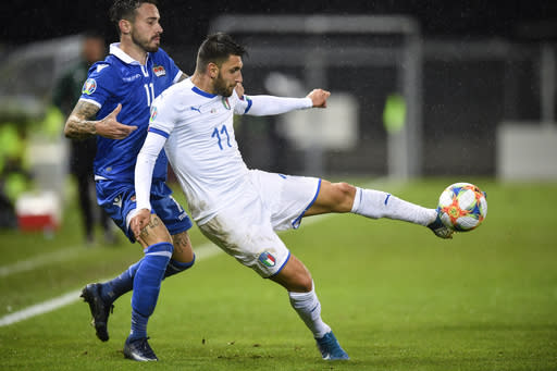 Liechtenstein's Dennis Salanovic, left, and Italy's Vincenzo Grifo compete for the ball during their Euro 2020 Qualifying, Group J soccer match in Vaduz, Liechtenstein, on Tuesday, Oct. 15, 2019. (Gian Ehrenzeller/Keystone via AP)