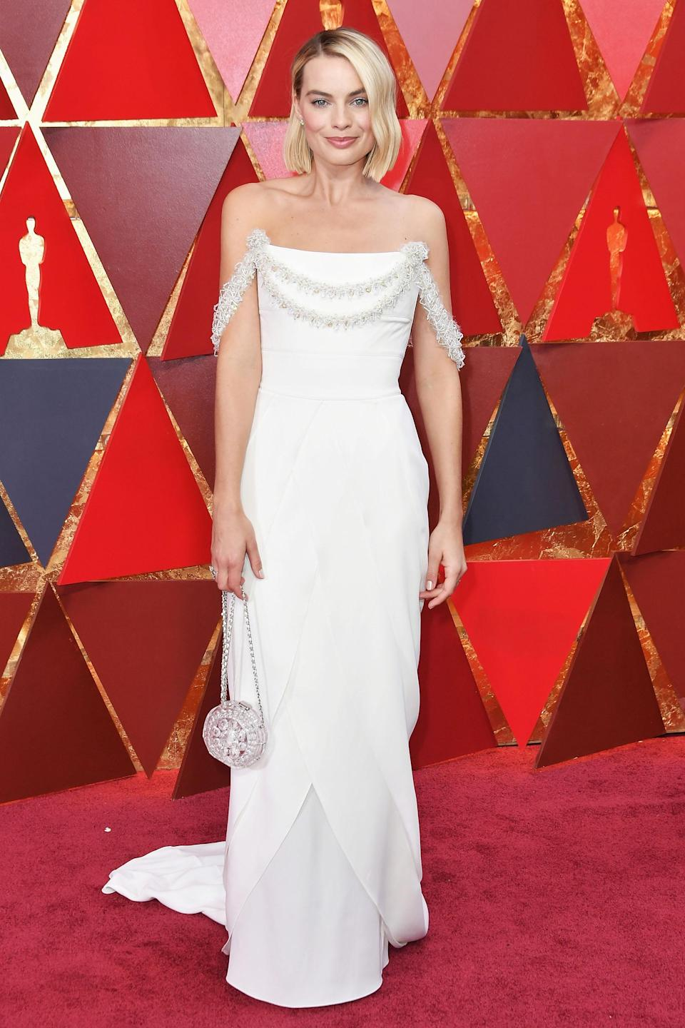 """<h2>Margot Robbie, 2018</h2><br>Margot Robbie was a breath of fresh air in this showstopping white gown courtesy of Chanel.<br><br><em>Margot Robbie in Chanel.</em><span class=""""copyright"""">Photo: Neilson Barnard/Getty Images.</span>"""