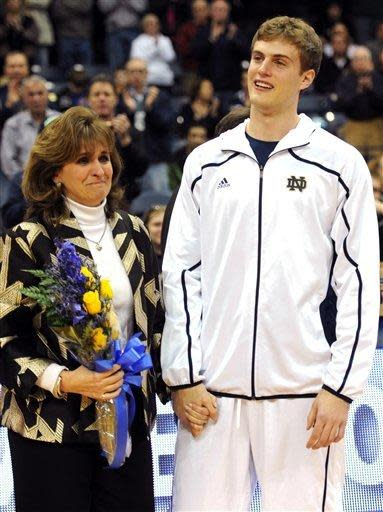 Notre Dame forward Tim Abromaitis stands with his mother, Deb, during a senior day ceremony prior to an NCAA college basketball game against Providence Friday, March 2, 2012, in South Bend, Ind. (AP Photo/Joe Raymond)