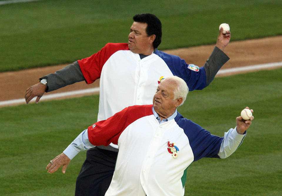 Hall of Fame and former Los Angeles Dodgers manager Tommy Lasorda passed away at the age of 93. Dodger greats Fernando Valenzuela ,top, and Tommy Larsoda during the final game between Japan and Korea in the World Baseball Classic at Dodger Stadium on Monday March 23, 2009 in Los Angeles. (Keith Birmingham/The Orange County Register via AP)
