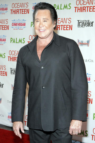 "FILE - This June 6, 2007 file photo shows singer Wayne Newton at the premiere of ""Ocean's Thirteen"" at the Palms Hotel-Casino in Las Vegas. A federal bankruptcy judge is poised to sign off Friday June 21, 2013, on a legal settlement will result in Newton moving from his sprawling ""Casa de Shenandoah"" property after 45 years. (AP Photo/Jae C. Hong, File)"