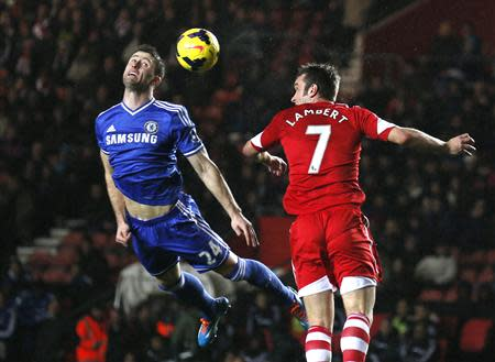 Chelsea's Gary Cahill (L) is challenged by Southampton's Rickie Lambert during their English Premier League soccer match at St Mary's stadium in Southampton, southern England January 1, 2014. REUTERS/Stefan Wermuth