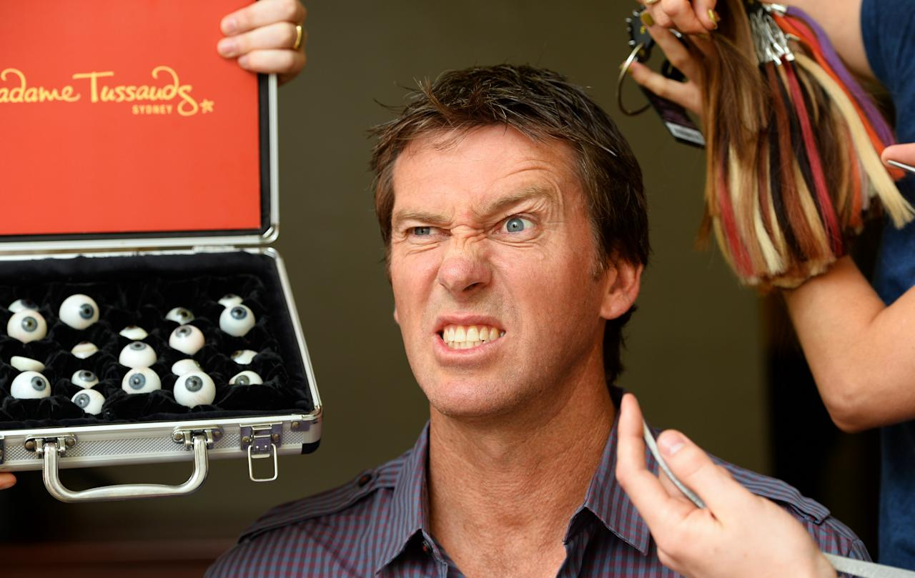 Former Australian cricket star Glenn McGrath holds still as a team from Madame Tussauds takes over 250 measurements along with exact colour matches of his eyes, skin tone and hair to make the final figure, in Sydney on February 13, 2013.  The team will now fly back to the Madame Tussauds headquarters in London where they will take a further 800 hours to create and perfect McGrath?s figure before going on display along side fellow cricketing legend Shane Warne aT Madame Tussauds in Sydney.  AFP PHOTO/William WEST        (Photo credit should read WILLIAM WEST/AFP/Getty Images)