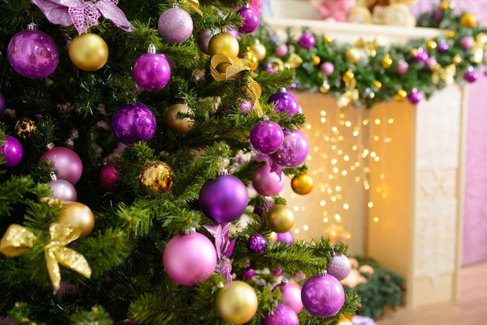 purple and gold ornaments on christmas tree