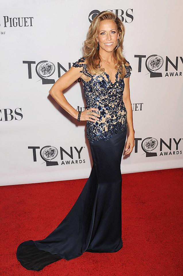 Aniston's pal Sheryl Crow made her first red carpet appearance since announcing that she has a benign brain tumor at the 66th Annual Tony Awards on Sunday evening. Sporting an embroidered, navy Marchesa masterpiece, the singer/songwriter -- who's already beaten breast cancer -- wasn't going to let the news of her latest medical scare keep her from attending the show. Good for her! (6/10/2012)