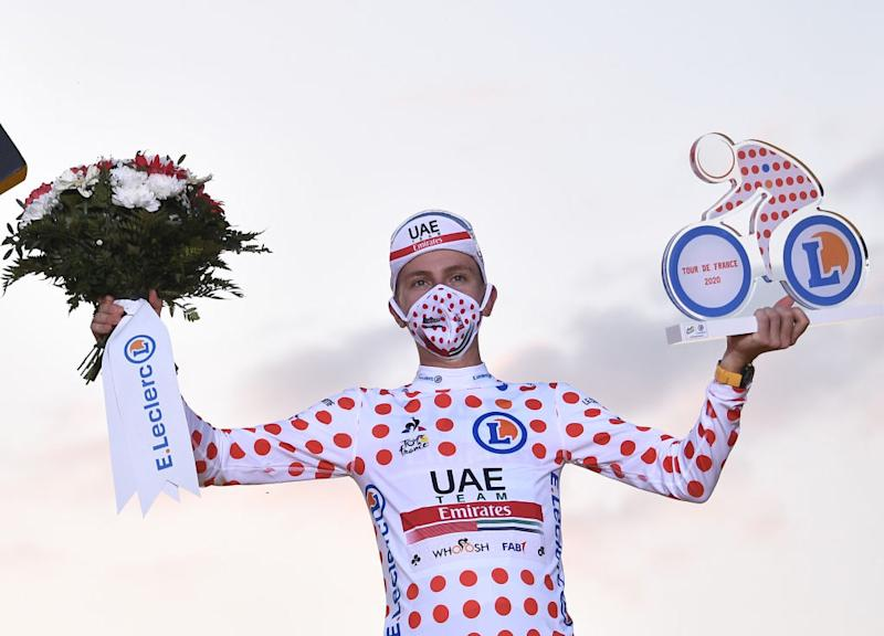 Team UAE Emirates rider Slovenias Tadej Pogacar celebrates on the podium after winning the best climbers polka dot jersey of the 107th edition of the Tour de France cycling race after the 21st and last stage of 122 km between ManteslaJolie and Champs Elysees Paris on September 20 2020 Photo by AnneChristine POUJOULAT AFP Photo by ANNECHRISTINE POUJOULATAFP via Getty Images