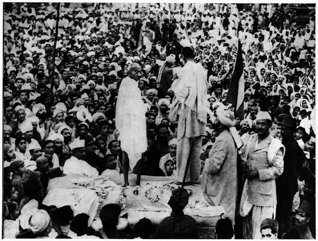 Mahatma Gandhi speaking to the crowd on a makeshift stage druing a rally. Peshawar, July 1938 (Photo by Mondadori via Getty Images)