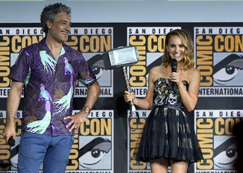 Natalie Portman (with director Taika Waititi) wields the mighty hammer for the fourth