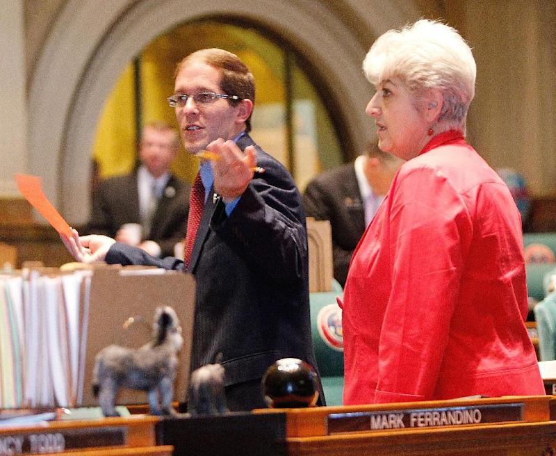 FILE - This May 9, 2012, file photo shows House Minority Leader Mark Ferrandino, left,  with  Rep. Lois Court, D-Denver,  in the House chamber at the Capitol in Denver on the last day of the session. Democratic lawmakers picked Denver Rep. Mark Ferrandino on Thursday Nov. 8, 2012, to lead the House, which they re-took in this week's election. Ferrandino is the first openly gay House speaker in state history.  (AP Photo/Ed Andrieski, file)