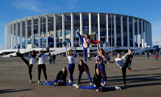 Soccer Football - Russian Football National League - FC Olimpiyets Nizhny Novgorod vs Rotor Volgograd - Nizhny Novgorod Stadium, Nizhny Novgorod, Russia - April 28, 2018 Cheerleaders perform in front of the stadium before the match. REUTERS/Sergei Karpukhin