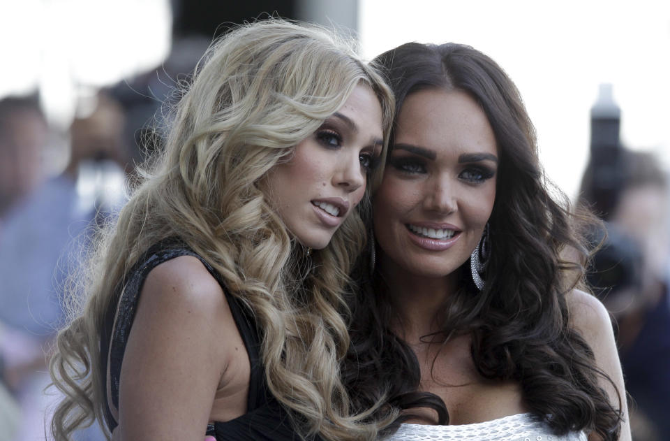 Tamara Ecclestone , right and her sister Petra ,daughters of Bernie Ecclestone, president and CEO of Formula One Managment, before a charity fashion show in Monaco, Friday, May 27, 2011. The Monaco Formula One Grand Prix will take place here on Sunday, May 29, 2010. (AP Photo/Luca Bruno)