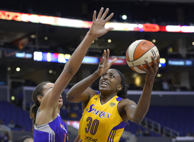Los Angeles Sparks forward Nneka Ogwumike, right, puts up a shot as Phoenix Mercury center Brittney Griner defends during the first half in Game 3 of a WNBA basketball Western Conference semifinal series, Monday, Sept. 23, 2013, in Los Angeles. (AP Photo/Mark J. Terrill)