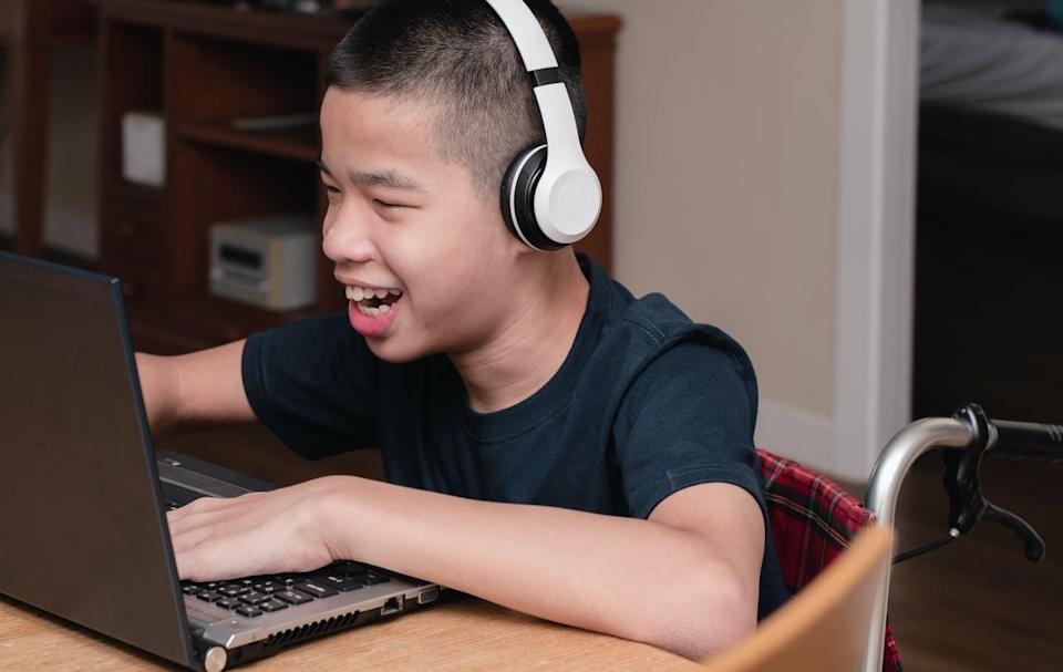 """<span class=""""caption"""">One parent of a child with physical disabilities said their child preferred online learning because 'his physical disabilities aren't a barrier to inclusion ... '</span> <span class=""""attribution""""><span class=""""source"""">(Shutterstock)</span></span>"""