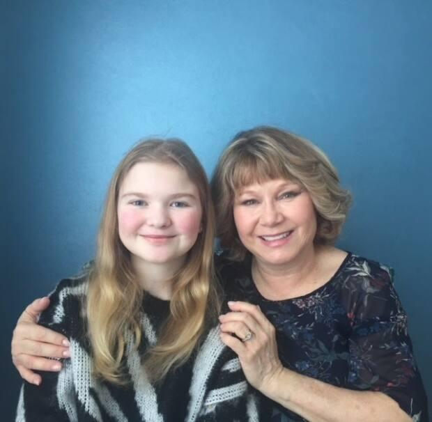 Laura Stevens, left, poses with her mother Sandy Stevens, right. Laura was diagnosed with cystic fibrosis as a baby, but is excited about a new drug on the market to treat the illness. (Submitted by Sandy Stevens - image credit)