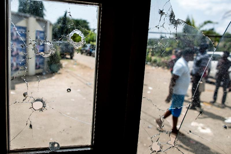Bullet holes in the window of a guard post on the gate of Gabon's opposition leader Jean Ping's headquarters in Libreville (AFP Photo/Marco Longari)
