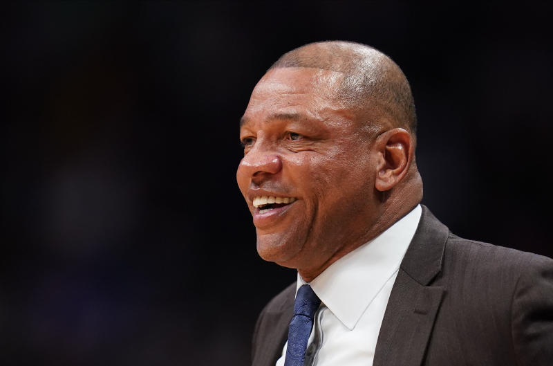 LA Clippers head coach Doc Rivers smiles during the second quarter of an NBA basketball gameagainst the Denver Nuggets, Sunday, Jan. 12, 2020, in Denver. (AP Photo/Jack Dempsey)