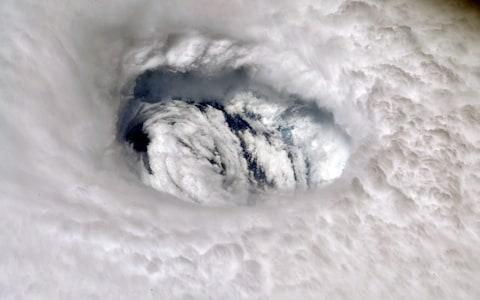 A handout photo made available by NASA shows an image of Hurricane Dorian's eye taken by NASA astronaut Nick Hague - Credit: NASA HANDOUT/EPA-EFE/REX