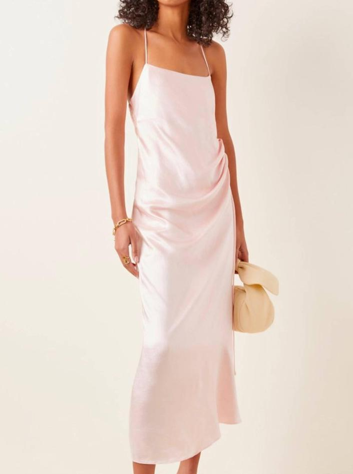 """Don't worry—it's not white, it's pale pink—and the ruche detailing and spaghetti strap back is pure minimalist perfection. $230, Moda Operandi. <a href=""""https://www.modaoperandi.com/women/p/significant-other/aura-satin-slip-dress/435576"""" rel=""""nofollow noopener"""" target=""""_blank"""" data-ylk=""""slk:Get it now!"""" class=""""link rapid-noclick-resp"""">Get it now!</a>"""