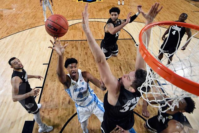 <p>Isaiah Hicks #4 of the North Carolina Tar Heels shooots against Zach Collins #32 of the Gonzaga Bulldogs in the first half during the 2017 NCAA Men's Final Four National Championship game at University of Phoenix Stadium on April 3, 2017 in Glendale, Arizona. (Photo by Chris Steppig – Pool/NCAA Photos via Getty Images) </p>