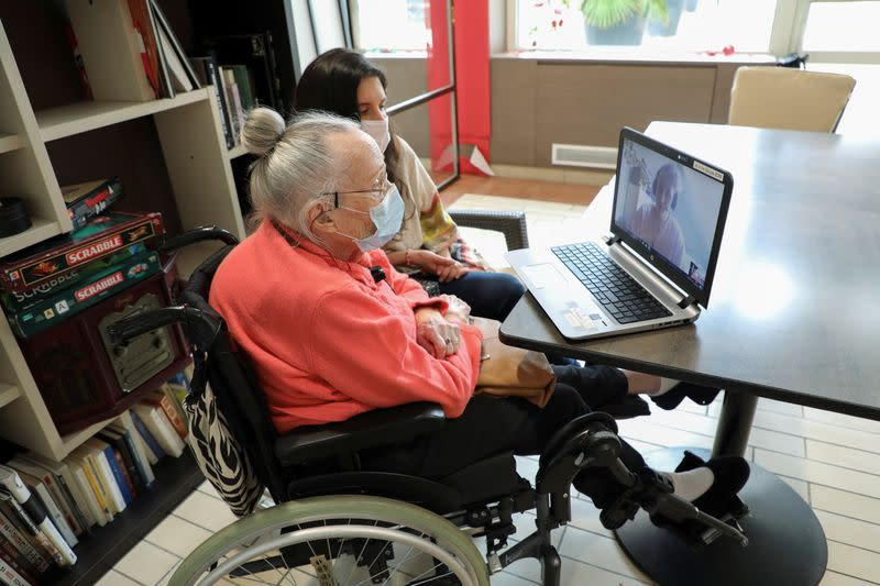 Elderly people and students studying French use video conference to beat lockdown blues
