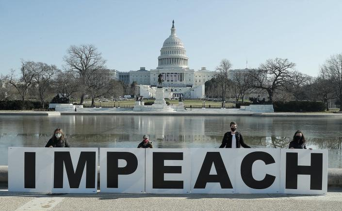 """<span class=""""caption"""">A different type of protest comes to the Capitol.</span> <span class=""""attribution""""><a class=""""link rapid-noclick-resp"""" href=""""https://www.gettyimages.com/detail/news-photo/people-gather-at-the-base-of-the-u-s-capitol-with-large-news-photo/1296007459?adppopup=true"""" rel=""""nofollow noopener"""" target=""""_blank"""" data-ylk=""""slk:Paul Morigi/Getty Images for MoveOn"""">Paul Morigi/Getty Images for MoveOn</a></span>"""