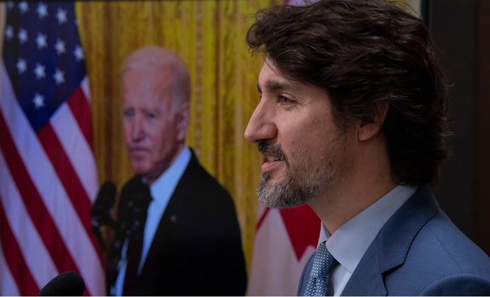 United States President Joe Biden listens as Canadian Prime Minister Justin Trudeau delivers his statement during a virtual joint statement following a virtual meeting in Ottawa on Feb. 23, 2021. (Photo: CP/Adrian Wyld)