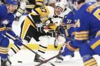 Pittsburgh Penguins forward Sidney Crosby (87) passes the puck during the second period of an NHL hockey game against the Buffalo Sabres, Sunday, April 18, 2021, in Buffalo, N.Y. (AP Photo/Jeffrey T. Barnes)