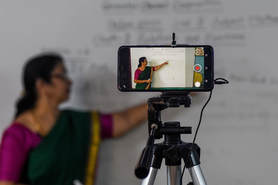 A school teacher gives an online class at a government school in Chennai on June 3, 2020. (Photo: ARUN SANKAR via Getty Images)