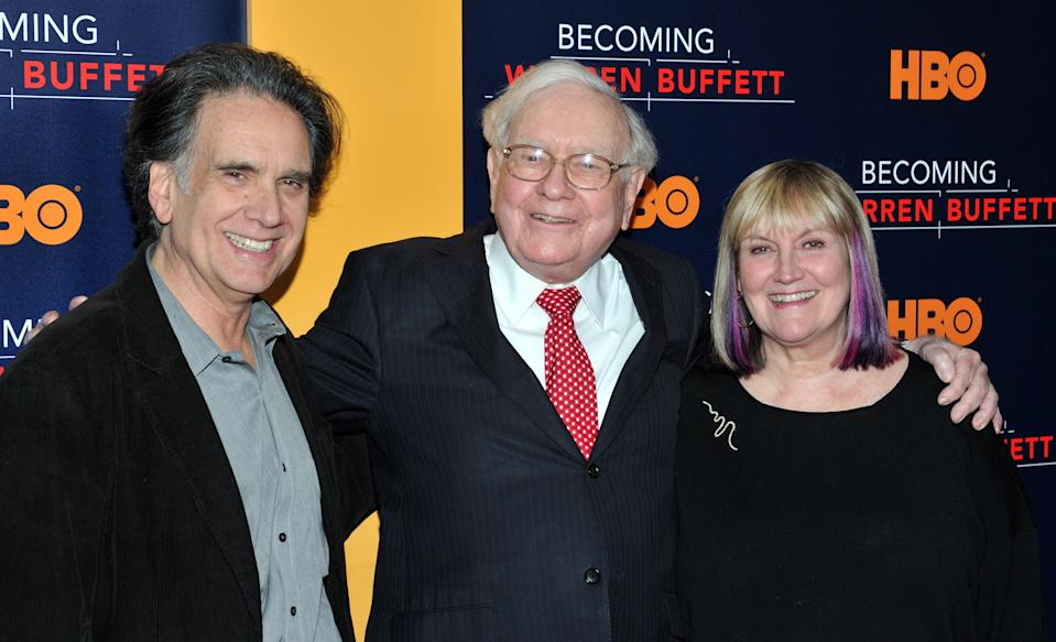 "L-R: Peter, Warren and Susie Buffett attend the world premiere of ""Becoming Warren Buffet"" (HBO Documentary Films) at the Museum of Modern Art in New York, NY on January 19, 2017. (Photo by Stephen Smith) *** Please Use Credit from Credit Field ***"