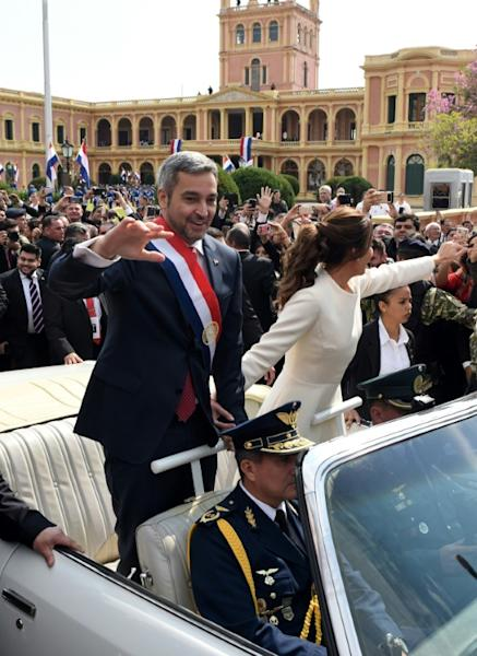 Paraguay's new President Mario Abdo Benitez and his wife Silvana Lopez head to Asuncion's Cathedral after his swearing in on August 15, 2018