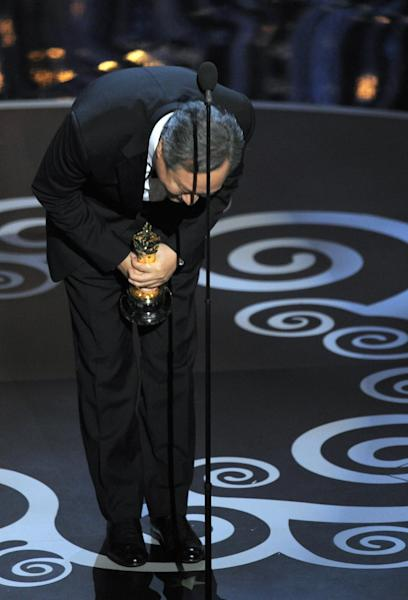 """Ang Lee accepts the award for best directing for """"Life of Pi"""" during the Oscars at the Dolby Theatre on Sunday Feb. 24, 2013, in Los Angeles. (Photo by Chris Pizzello/Invision/AP)"""